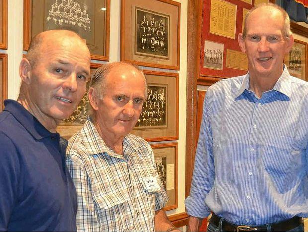 Geoff Richardson, room co-ordinator Peter Coote and Wayne Bennett in the Cowboys memorabilia room.