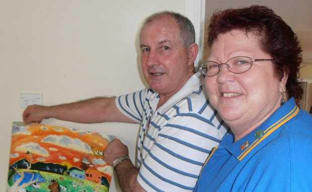 Lions Club of Dalby president Glenn Shipway and district governor Kaye Smith admire the Ella Baird's winning poster.