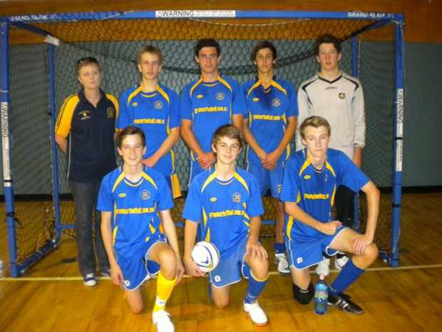 WINNERS: The Toowoomba Grammar School under 16 futsal team of Jack Waters (back left), Connor Simon, Riley Cooper, Janelle Cooper (coach), Michael van Gend, Coen Oates, Mitchell Hunter and Matthew Crowe.
