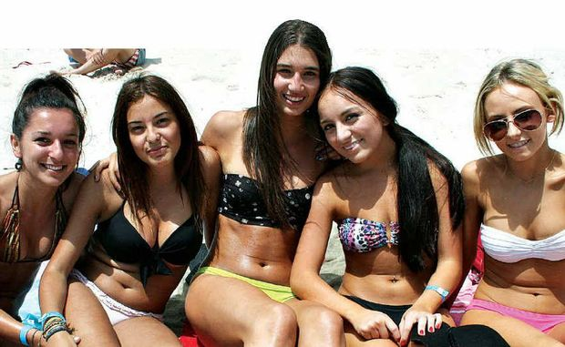BEACH BABES: Soaking up the sun at Main Beach on Monday are Sydney girls (from left) Sabrina Laianca, Angelica Deluca, Roberta Pecoraro, Jessica Restrepo and Stephanie Di Coio.