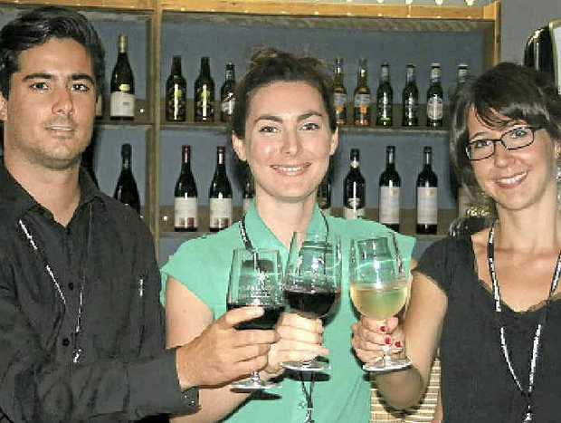 CHEERS: Toasting the success of the new Palace Cinema in Byron Bay are bar staff Oli Ayo and Steph Cameron (right) with acting assistant manager Sophie Kobic.