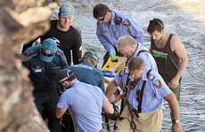 An elderly woman is rescued by emergency services personnel at the base of Moffat Headland. The dazed woman could not say how she suffered her injuries.