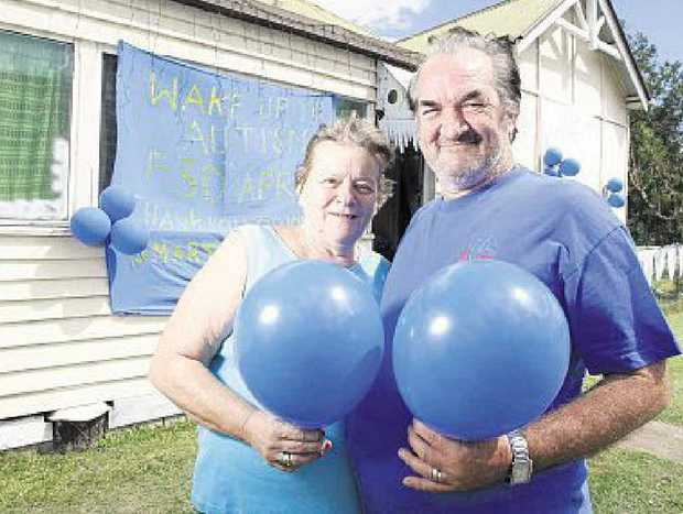 LIGHTING IT UP: David and Dianne Collins in front of their house. INSET: Luke Lockie.