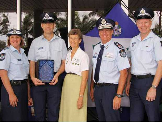 WELL DONE: Sergeant Nadine Webster (left) is joined by Police Commissioner Ian Stewart (second from right) and Senior Sergeant Jason Hopgood (far right) in congratulating Goodna Sergeant Ian Stephens and Betty Bork on winning state awards for their work with Neighbourhood Watch.