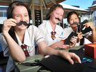 GIRLS from St Mary's College are doing their bit to support Movember by selling paper moustaches to their friends.