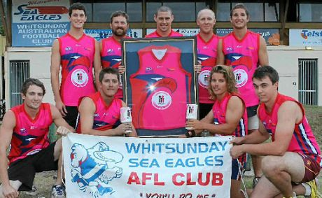 Whitsunday Sea Eagles players will be selling raffle tickets for this framed commemorative jersey at Centro this coming Saturday, November 24. Pictured here are, back row: Matthew Laskey, Sam Walker, Daniel Fletcher, Troy Weller and Robert Gillespie and front row: Zach Mader, Jade Derbyshire, Dane Winstanley and Trevor Ritchie.