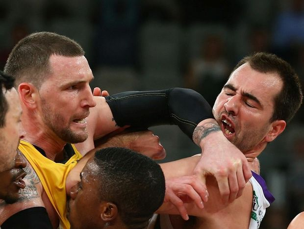 Seth Scott of the Tigers elbows Ian Crosswhite of the Kings during the round seven NBL match between the Melbourne Tigers and the Sydney Kings.