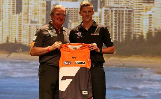 Lachie Whitfield is presented with GWS jersey by Kevin Sheedy during the 2012 AFL Draft at the Gold Coast Exhibition Centre on November 22.