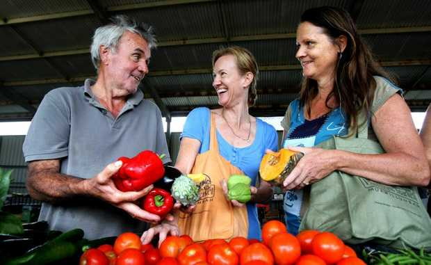 At the Caldera Farmers market (from left) are Des Cecil, Vicki Barnes and Deb Fuller. Photo: John Gass / Daily News