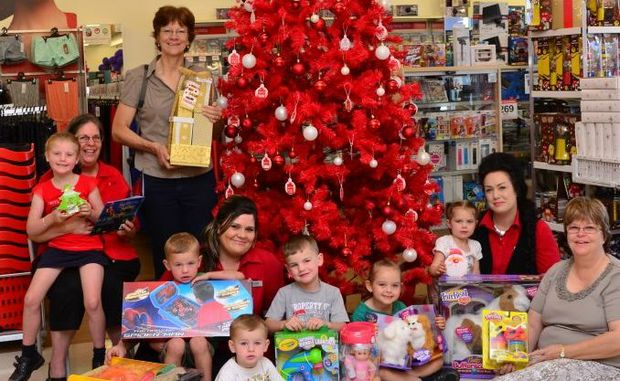 CHRISTMAS WISH: UnitingCare Community's Ros Heit, Susan Mortimer, Amanda Parnell, Brooke Darr, Claire Gibson, Hannah Needer, Rhianon Braithwaite, Harrison Braithwaite, Lawson Braithwaite, Lucy Needer and Patterson Braithwaite get into the spirit of Christmas.