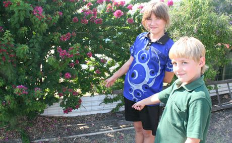 SCARY ENCOUNTER: Trinity and Holly Denniss-Walker point to where the snake was spotted just days before it came into the house.