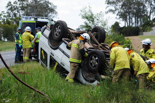 Firefighters at the scene of a four-wheel drive rollover at Craignish.