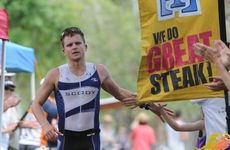 Brian McLeod celebrates just before crossing the finish line to win the Hervey Bay 100 on Sunday.