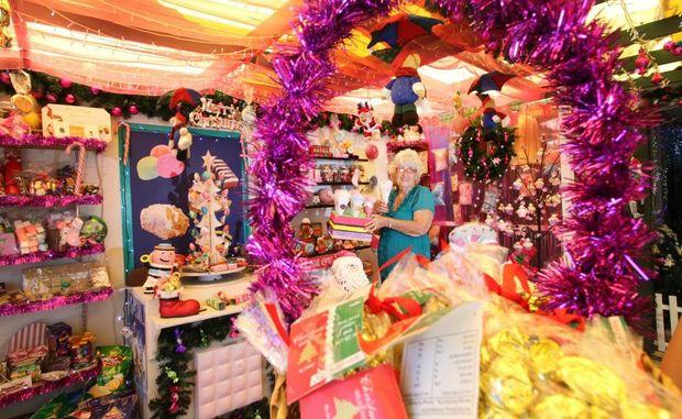 Faye Trewick at her amazing Christmas lights display in her home at Woodridge. Photo: Inga Williams / The Satellite