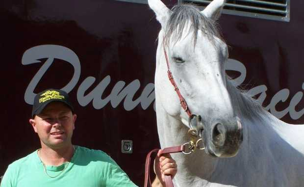 Trainer Matt Dunn and ghostly grey, The White Hope. Contributed / Daily News