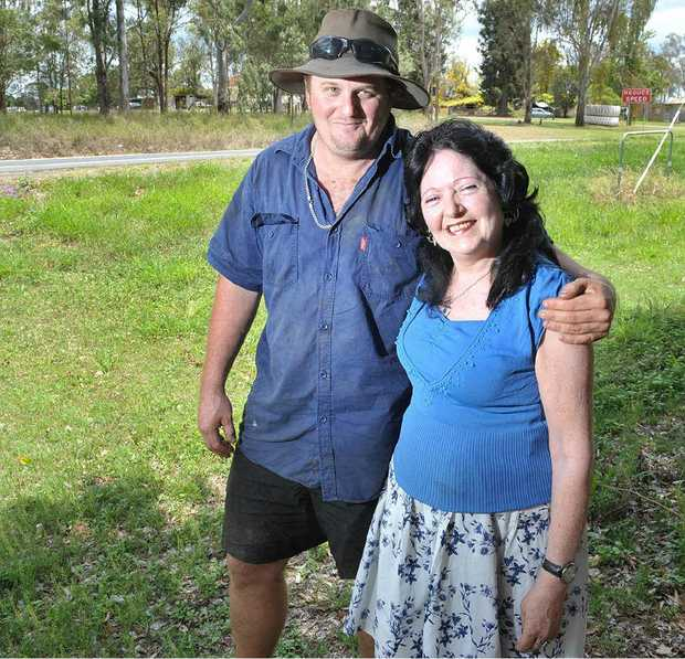 FAMILY SUPPORT: Clint Wilson with his mum Mary Wilson at the same stretch of the Cunningham Highway where Mary was involved in a traffic accident in 1987 which killed one woman and left Mary in hospital for three months. Clint witnessed the accident.