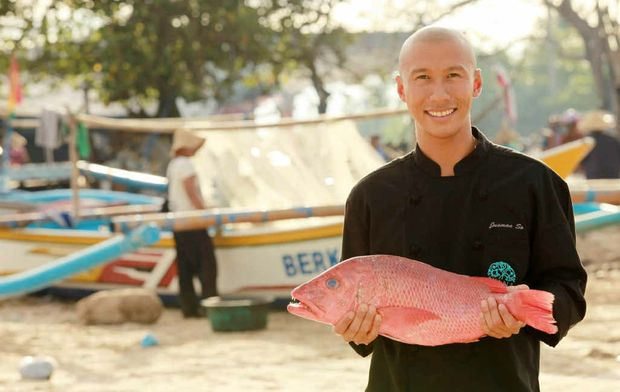 Dava head chef Jusman So selects a fish from the markets at Jimbaran Bay.