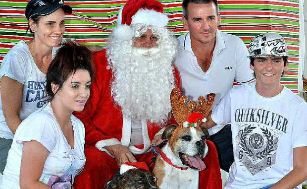 The Rath family, Anthony, Donna, Madison, Cooper and pets Jesse and Max pose with Santa.