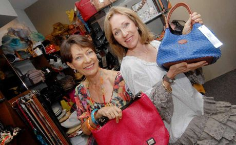 M'Lady's Shoe Boutique owners Jan Simpson with Sue Walker find that in the shoe business, people often prefer to try before they buy.