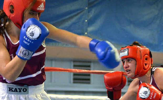 MOVING TARGET: Courtney Kingston fails to land this punch on a ducking Shari Ranger in the Senior Female Division in Mackay at the weekend. INSET: Clarence Mitchell.
