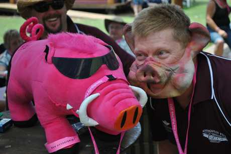 """A PAIR OF HAMS: Sydney resident Wayne Mosch gets into the spirit of the Nindigully Pig races by hamming it  up for the camera with event mascot """"Bourney"""" on Saturday morning."""