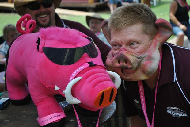 "A PAIR OF HAMS: Sydney resident Wayne Mosch gets into the spirit of the Nindigully Pig races by hamming it  up for the camera with event mascot ""Bourney"" on Saturday morning."