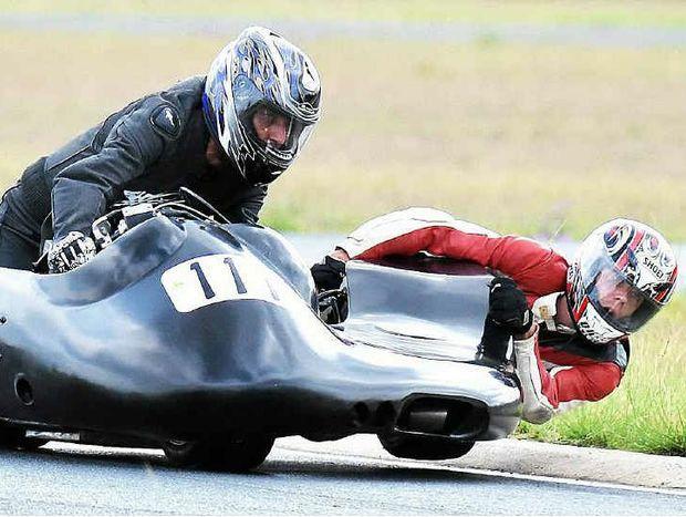 Warwick sidecar racer Barry Martin and swinger/passenger Ryan Munns at Morgan Park on Saturday.