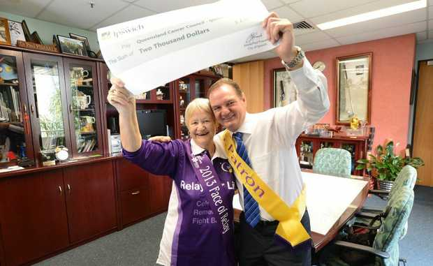 Mayor Paul Pisasale with breast cancer survivor Colleen Julian. The Ipswich City Council has made a $2000 donation to the Cancer Council Queensland's Relay for Life which brings total donations to one million dollars.