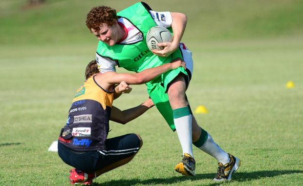 Brodie Dreger (left) tackles Dan Pearce during the CQ Brahmans' skill testing at CQ University. Photo: Sharyn O'Neill.