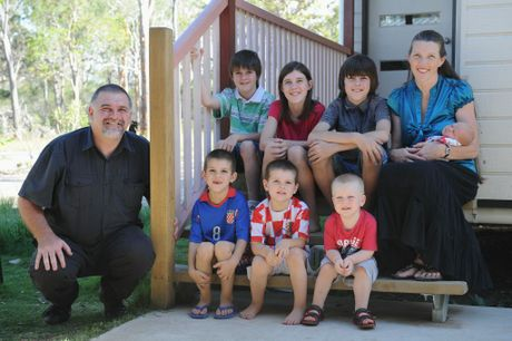 Michael and Sharon Radic with one-week-old Reilly and (clockwise from bottom right) Gideon, 2, Hogan, 4, Harley, 6, Judah, 8, Jordan, 12, and Micah, 10.