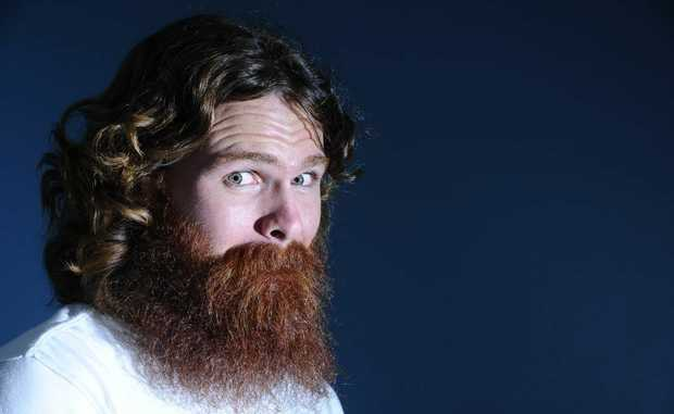 Ben Flavell will shave off his ginger beard for Movember if he raises over $300. Ben performs one of his party tricks for the camera, where he hides his lips with his moustache. Photo: JoJo Newby / The Daily Examiner