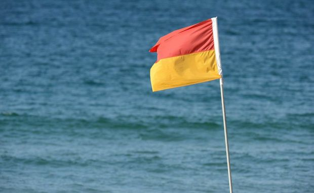 Red and yellow beach flag at Mooloolaba Beach. Photo:Warren Lynam / Sunshine Coast Daily