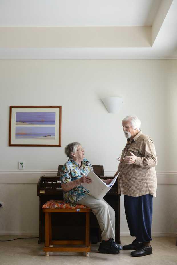 June Palmer and David Taylor, residents at Mareeba Nursing Home. June transcribed the music for David's original play, The Summer of 64. Photo: Adam Hourigan / The Daily Examiner