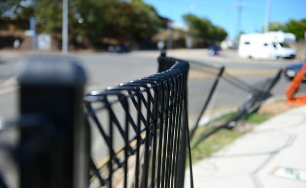 Fence bent on Hanson Road and Yarroon Street, Gladstone.