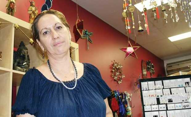 Ann Healy is upset after police raided her Enchantment stores at Yeppoon and Rockhampton.