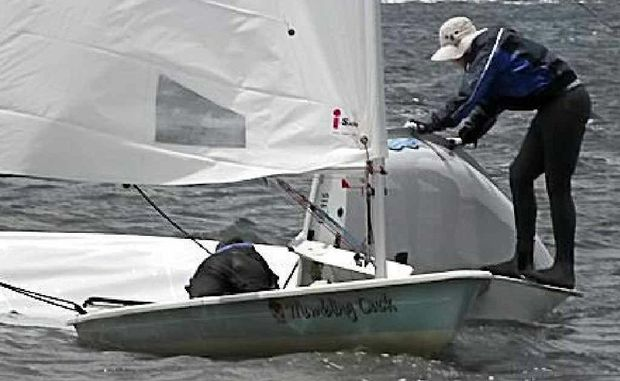 A Big River Sailing Club competitor works on righting his capsized craft. PHOTO: CONTRIBUTED