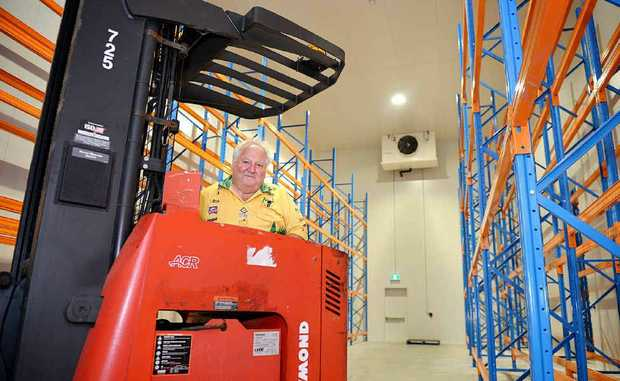 Charlie Horne in the driver's seat in his new Cooloola foods building.