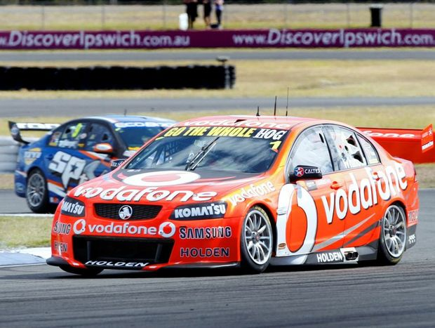 Jamie Whincup on the track at Queensland Raceway.