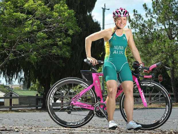 AUSTRALIAN HONOURS: Ipswich triathlete Rebecca Nunn is keen to represent her country next year after facing testing conditions at the world championships in New Zealand.