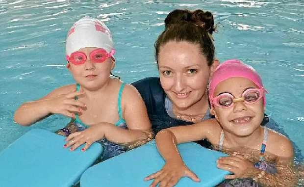 LIFESAVER: Swimming Instructor Sarah Jeffrey with mini graduates from the Aboriginal Swimming Program Violet Squires (left) and Amarni Caldwell.