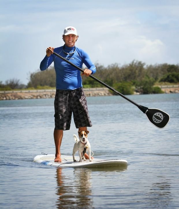 Pat Eastwood and his dog Ally on a stand up paddle board. Photo Allan Reinikka / The Morning Bulletin