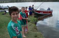 A group of young anglers waiting for a bite at the weekend fishing competition at Mingo Crossing.