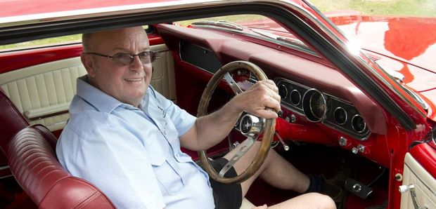 Geoffrey Voll kicks back in style inside the flawless interior of his 1966 Ford Mustang.