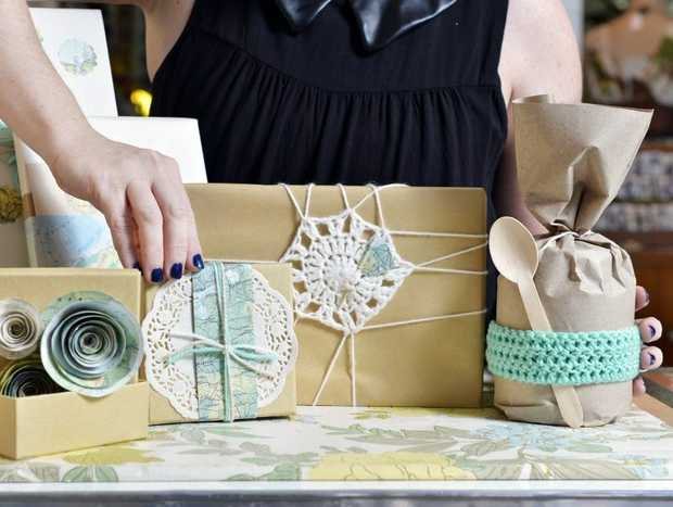 Kyla D'Aubbonnett adds the finishing touches to some beautifully wrapped Christmas gifts. Cultiver will host gift wrapping workshops from Saturday, December 8.