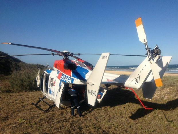 The AGL Action Rescue Helicopter airlifted two men, who had been pinned under a Fraser Island tourist bus, to Hervey Bay Hospital on Wednesday.