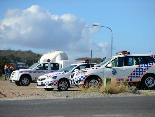 Police monitor a union protest on Port Central Way, Gladstone, for the second day in a row.