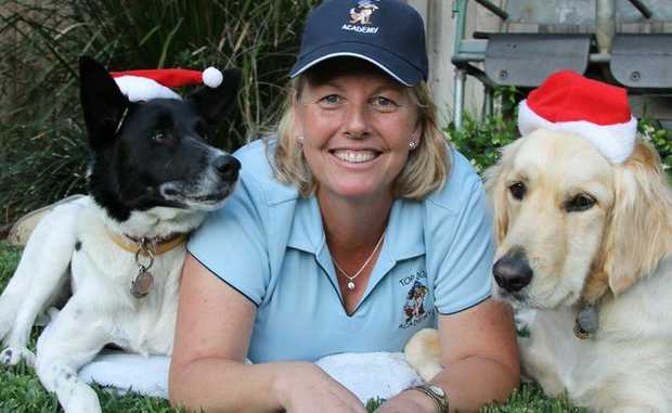 Local dog trainer Rhonda Robinson with Top Dog Academy students, Pandas and Aspen.