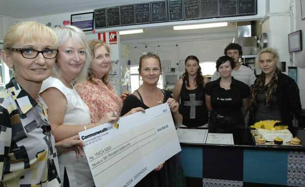 Commonwealth Bank customer service manager Fiona Montgomery and branch manager Julie Magner present YWCA senior manager Johnny Iuso with a cehck for the YWCA Pulse Cafe in Lismore. Photo Marc Stapelberg / The Northern Star