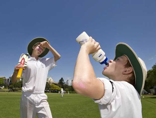 Toowoomba Grammar School junior cricketers Nic Jones (left) and Darcy Murphy feel the heat while competing against The Southport School today.