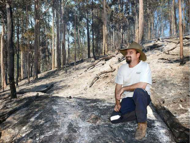 Mark Grennan on his burnt property at Goomboorian yesterday.